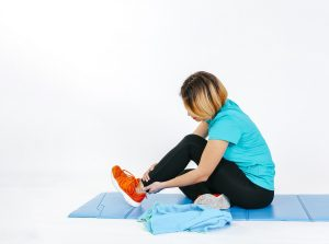 fit woman with foot pain